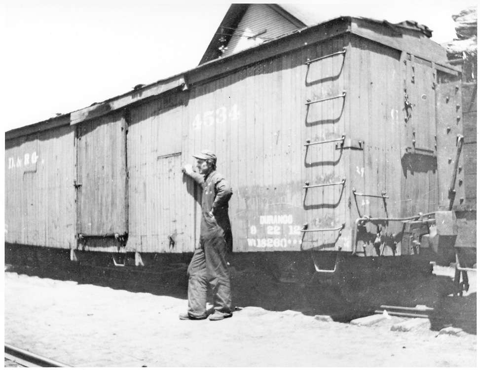 "3/4 view, mostly of ""A"" end, of box car #4534.  This car was built in 1881 as Class 3, 24', 10-ton.<br /> D&RG  Durango, CO  ca. 1912<br /> In book ""Durango: Always a Railroad Town (1st ed.)"" page 74<br /> Same as RD054-038."