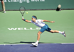 March 15, 2019 - Indian Wells, CA, U.S. - INDIAN WELLS, CA - MARCH 15: Roger Federer (SUI) hits a forehand during the quarterfinals of the BNP Paribas Open on March 15, 2019, at the Indian Wells Tennis Gardens in Indian Wells, CA. (Photo by Adam Davis/Icon Sportswire) (Credit Image: © Adam Davis/Icon SMI via ZUMA Press)