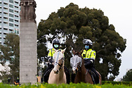 MELBOURNE, VIC - SEPTEMBER 12: Mounted Police stand ready for a would be protest during the Melbourne Freedom Walk Rally on September 12, 2020 in Melbourne, Australia. Stage 4 restrictions are in place from 6pm on Sunday 2 August for metropolitan Melbourne. This includes a curfew from 8pm to 5am every evening. During this time people are only allowed to leave their house for work, and essential health, care or safety reasons. Despite this, multiple protests are being arranged to push back against the draconian restrictions in place within metropolitan Melbourne. A Freedom Walk was arranged to take place in the Tan but with hundreds of police and wet weather forecast, only a small number of protesters tried to attend before being ordered to move on. (Photo by Dave Hewison/Speed Media)
