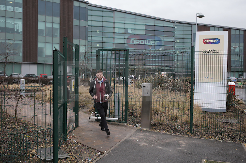 © Under licence to London News Pictures. 08/03/2016. A worker leaves the Npower offices in Houghton-le-Spring, County Durham, UK. The company has announced it will cut 2,400 jobs in the UK by 2008. March 8th Photo Credit: Stuart Boulton/LNP