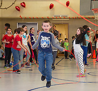 Students from Kindergarten through 5th grade participate in the Jump for Heart event at Elm Street School on Thursday afternoon.  (Karen Bobotas/for the Laconia Daily Sun)