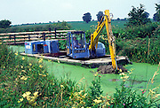 Dredging the Kennet and Avon canal, Wiltshire, England, UK