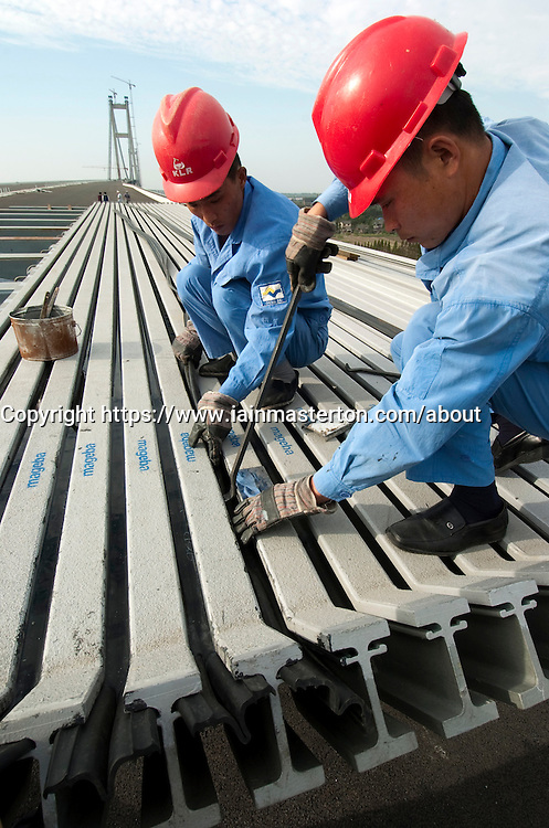 Inspecting lrge modular bridge deck expansion joints at Runyang Bridge in China currenly the longest bridge in China