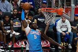 March 10, 2018 - Los Angeles, CA, U.S. - LOS ANGELES, CA - MARCH 10: LA Clippers forward Montrezl Harrell (5) goes to the basket for a slam dunk during the game between the Orlando Magic and the LA Clippers on March 10, 2018, at STAPLES Center in Los Angeles, CA. (Photo by David Dennis/Icon Sportswire) (Credit Image: © David Dennis/Icon SMI via ZUMA Press)