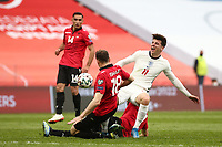 TIRANA, ALBANIA - MARCH 28: Mason Mlunt of England is fouled by Adrian Ismajli of Albania during the FIFA World Cup 2022 Qatar qualifying match between Albania and England at the Qemal Stafa Stadium on March 28, 2021 in Tirana, Albania. Sporting stadiums around Europe remain under strict restrictions due to the Coronavirus Pandemic as Government social distancing laws prohibit fans inside venues resulting in games being played behind closed doors (Photo by MB Media)