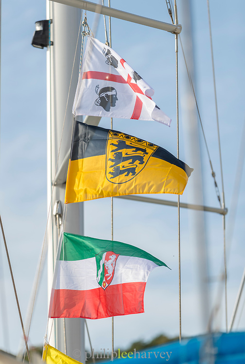 Close up of flags on windy day on ship, Bonifacio, Corsica, France