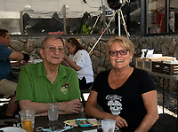 """""""Cousin"""" Bob and Judy Somerville enjoy lunch outside under the tent at the 405 Pub and Grill on Wednesday.  (Karen Bobotas/for the Laconia Daily Sun)"""