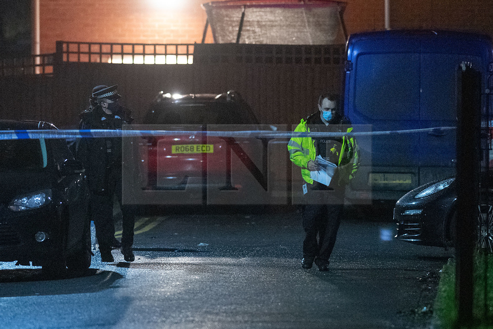 © Licensed to London News Pictures. 07/02/2021. Reading, UK. Uniformed police officers inside the cordon at the Tilehurst crime scene. At approximately 18:55GMT on Saturday 06/02/2021 Thames Valley Police were called to reports of an altercation in Dulnan Close, Tilehurst in Reading. A 25-year-old man sustained multiple injuries and died at the scene. Photo credit: Peter Manning/LNP