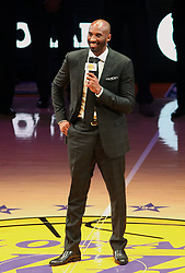December 18, 2017 - Los Angeles, California, U.S - Former Los Angeles Laker Kobe Bryant addresses the fans  at a halftime ceremony, retiring both of his jersey's during a  NBA basketball game between the Los Angeles Lakers and  the Golden State Warriors, in Los Angeles, Monday,  December 18, 2017. (Credit Image: © Prensa Internacional via ZUMA Wire)