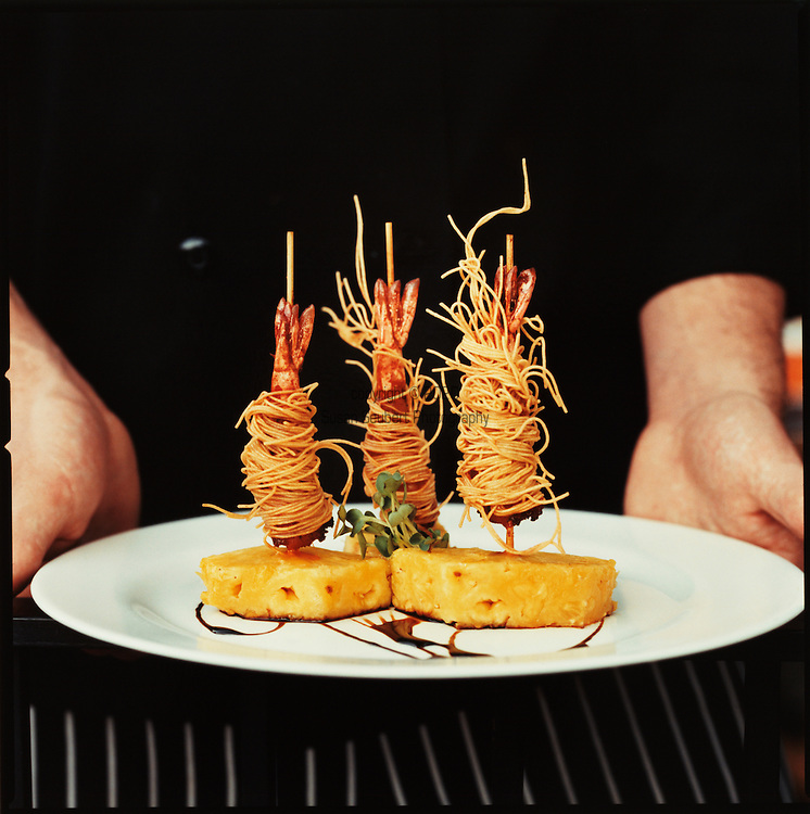 Prawns wrapped in noodles and then flash fried at Richard's restaurant.  Richard's specializes in natural and organic foods, fusion cuisine with a French flair.