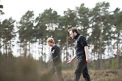 RSPB's Jane Sears and Back from the Brink's James Harding-Morris walking through heathland, after successful Field cricket Gryllus campestris translocation release, RSPB Farnham Heath Nature Reserve, Surrey, April