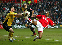 Photo: Chris Ratcliffe.<br />Charlton Athletic v Brentford. The FA Cup. 18/02/2006.<br />Shaun Bartlett (R) of Charlton closes in on Brentford keeper Stuart Nelson.