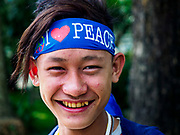 27 NOVEMBER 2017 - YANGON, MYANMAR: A Burmese teenager waits to see Pope Francis to Myanmar. Francis Pope Francis arrived in Yangon Monday for a four day / three night visit. Tuesday he is going to the capitol, Naypyidaw (Nay Pyi Taw) to meet with Aung San Suu Kyi and other Myanmar leaders. Wednesday and Thursday he is saying mass in Yangon and on Thursday afternoon he is going to neighboring Bangladesh. There are around 450,000 Catholics in Burma, about 1% of the total population.   PHOTO BY JACK KURTZ