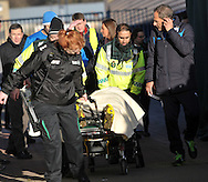 Tommy Smith of Huddersfield Town is taken to the Air Ambulance after the Sky Bet Championship match at the John Smiths Stadium, Huddersfield<br /> Picture by Graham Crowther/Focus Images Ltd +44 7763 140036<br /> 31/01/2015