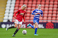 Manchester United defender Millie Turner (21) passes the ball during the FA Women's Super League match between Manchester United Women and Reading LFC at Leigh Sports Village, Leigh, United Kingdom on 7 February 2021.