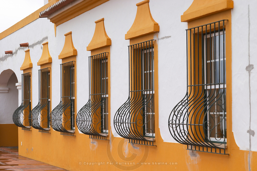 Reception building. Wrought iron bars protecting the windows. J Portugal Ramos Vinhos, Estremoz, Alentejo, Portugal