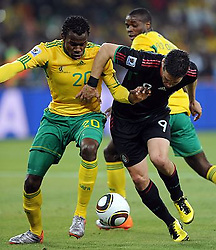 100611) -- JOHANNESBURG, June 11, 2010 (Xinhua) -- Guillermo Franco (R) of Mexico vies with Bongani Khumalo of South Africa during a group A match of the 2010 FIFA World Cup at Soccer City stadium in Soweto, suburban Johannesburg, on June 11, 2010. The match ended with a 1-1 tie. (Xinhua/Guo Yong) (ljq) (Credit Image: © Xinhua via ZUMA Wire)