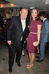ANDREW NEIL and PIPPA MIDDLETON at the 3rd birthday party for Spectator Life magazine hosted by Andrew Neil and Olivia Cole held at the Belgraves Hotel, 20 Chesham Place, London on 31st March 2015.