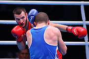 Ibragim Bazuev of Germany (left) and Stepan Hrekul of Ukraine compete in the Men's Light-heavyweight preliminaries during The Road to Tokyo European Olympic Boxing Qualification, Sunday, March 15, 2020, in London, United Kingdom. (Mitchell Gunn-ESPA-Images/Image of Sport)