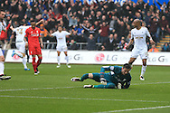Liverpool goalkeeper Danny Ward looks on dejected as Jack Cork of Swansea city scores his teams 2nd goal. Barclays Premier league match, Swansea city v Liverpool  at the Liberty Stadium in Swansea, South Wales on Sunday 1st May 2016.<br /> pic by  Andrew Orchard, Andrew Orchard sports photography.