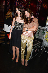 Left to right, STEPHANIE CAVALCANTI and CAROLINA TONG at the launch of Artegee held at The Wellington Club, 116A Knightsbridge, London on 11th June 2013.