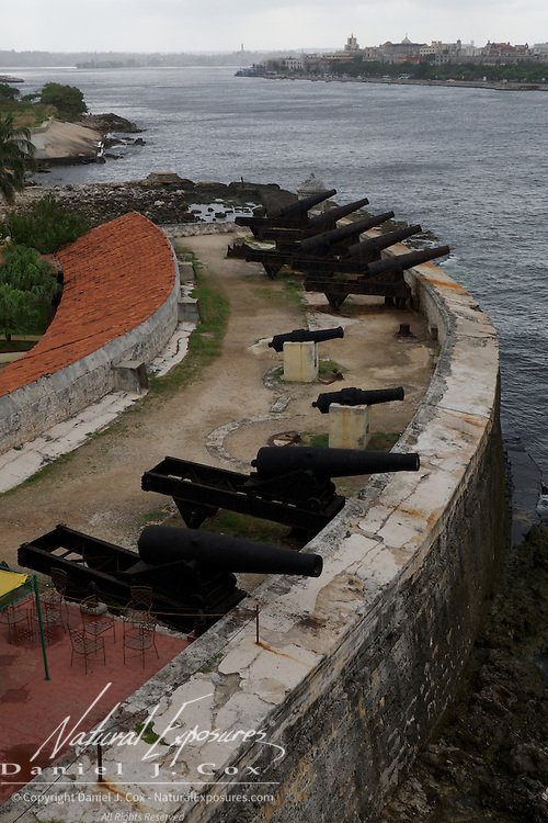 Canons lined up on the edge of the ancient Spanish Morro Castle, once used to protect Havana Harbor, Cuba