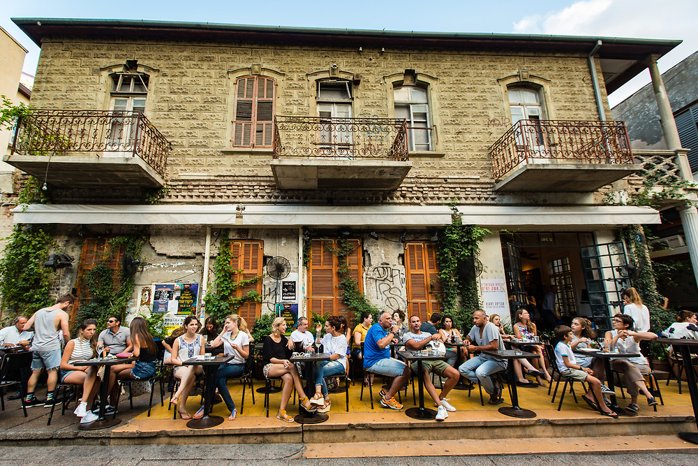 People are seen hanging out at Rothschild 12 Bar on Rothschild Boulevard in Tel Aviv's Lev Hair neighborhood