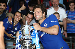 Chelsea's Marcos Alonso celebrates with the FA Cup trophy