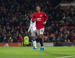 Marcus Rashford of Manchester United celebrates their second goal, an own goal by Ryan Jackson of Colchester United - Mandatory by-line: Jack Phillips/JMP - 18/12/2019 - FOOTBALL - Old Trafford - Manchester, England - Manchester United v Colchester United - English League Cup Quarter Final