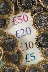 File photo dated 26/01/18 of money. A study from Unite found that increasing minimum wage rates to £10 an hour for workers over the age of 18 would boost public finances by £5.6 billion a year.