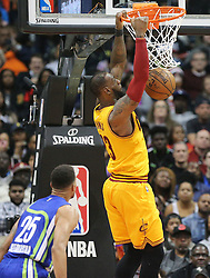 March 3, 2017 - Atlanta, GA, USA - Cavaliers LeBron James slams for two past Hawks guard Thabo Sefolosha during the second half in a NBA basketball game at Philips Arena on Friday, March 3, 2017, in Atlanta, GA. (Credit Image: © Curtis Compton/TNS via ZUMA Wire)