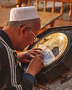 Engraver at work in the markets of Bukhara