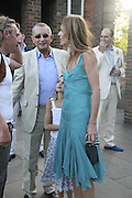 Trinny Woodall and Johnny eliachof. Conservative Party, Summer party, Royal Hospital Chelsea, Royal Hospital Road, London, SW3,3 July 2006. ONE TIME USE ONLY - DO NOT ARCHIVE  © Copyright Photograph by Dafydd Jones 66 Stockwell Park Rd. London SW9 0DA Tel 020 7733 0108 www.dafjones.com