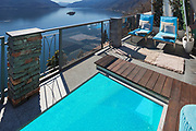 Terrace with pool and lake view in a luxury house