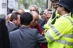 """London, September 21st, 2015. The Dalai Lama, who is on a visit to Britain, arrives amid anti-discrimination protests by Shugden Bhuddists, at the Lyceum Theatre in Covent Garden to host """"An Afternoon with the Dalai Lama and Friends""""."""