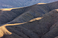 High Atlas Mountains with deep shadows early morning in Morocco.