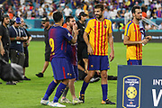 Barcelona Lionel Messi with Barcelona Gerard Pique and Barcelona Luis Suarez before they lift the cup during the International Champions Cup match between Real Madrid and FC Barcelona at the Hard Rock Stadium, Miami on 29 July 2017.