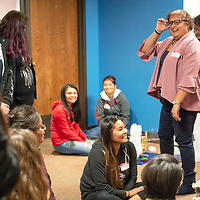 University of New Mexico Training & Development Consultant Ybeth Iglesias, right, laughs with the students during their group presentations during the Weimagination class at the UNM-Gallup campus on Nov. 30th.