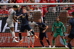 July 28, 2018 - Ann Arbor, MI, U.S. - ANN ARBOR, MI - JULY 28: Manchester United Keeper Lee Grant (13) looks on as Liverpool Defender Virgil Van Dijk (4) heads the ball over Manchester United Midfielder Scott McTominay (39) in the first half of the ICC soccer match between Manchester United FC and Liverpool FC on July 28, 2018 at Michigan Stadium in Ann Arbor, MI (Photo by Allan Dranberg/Icon Sportswire) (Credit Image: © Allan Dranberg/Icon SMI via ZUMA Press)