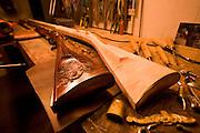 Two handmade guns sit on a workshop table in North Carolina gun and guitar maker Bobby Denton's shop