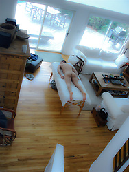 naked man on a massage table at home in The Hamptons