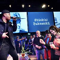 Nederland, Amsterdam , 8 maart 2014.<br /> harles Bukowski-party ter ere van de Amerikaanse auteur Charles Bukowski, die 9 maart 1994 - twintig jaar geleden-overleed. Met documentaires en korte films, een diner met kip en appelmoes en performances van o.a. Hugo Borst, Simon de Waal, Janneke van der Horst, Khalid Boudou, Naima El Bezaz en nog veel meer.<br /> Op de foto rapper Stick(s)<br /> <br /> Op de foto rapper Stick(s) Bukowski sluit de avond af.<br /> Foto:Jean-Pierre Jans