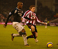 Photo: Aidan Ellis.<br /> Sheffield United v Manchester City. The Barclays Premiership. 26/12/2006.<br /> Sheffield's Rob Kozluk (R) tries to nip in front od City defender Sylvain Distin