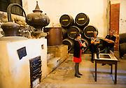 Tour guide explains brandy cognac production in Gonzalez Byass bodega, Jerez de la Frontera, Cadiz province, Spain