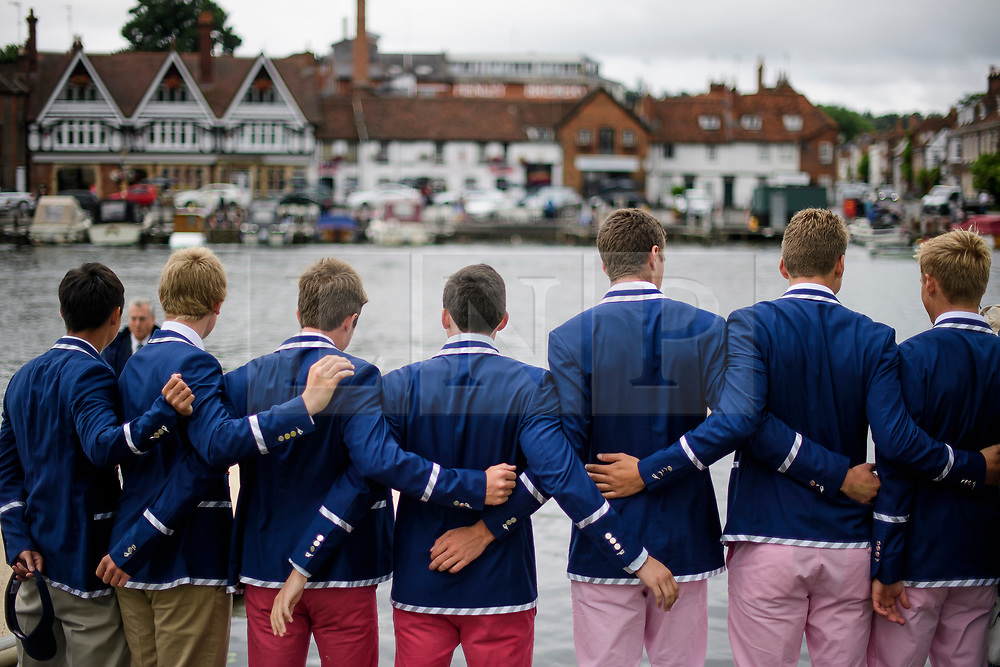 © Licensed to London News Pictures. 28/06/2017. London, UK. A group of man wearing the colours of Malvern Preparatory School rowing team watch day one of the Henley Royal Regatta, set on the River Thames by the town of Henley-on-Thames in England.  Established in 1839, the five day international rowing event, raced over a course of 2,112 meters (1 mile 550 yards), is considered an important part of the English social season. Photo credit: Ben Cawthra/LNP