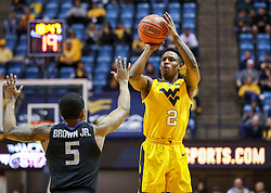 Feb 18, 2019; Morgantown, WV, USA; West Virginia Mountaineers guard Brandon Knapper (2) shoots a three pointer during the second half against the Kansas State Wildcats at WVU Coliseum. Mandatory Credit: Ben Queen-USA TODAY Sports