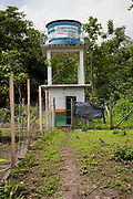 Water tower built by FUNAI on indigenous land. A third of Altamira in the state of Para, Brazil will be flooded to make way for the Belo Monte dam, nearly all the people affected are the poorest in society or indigenous communities that will have nowhere to go if they were made homeless, and the Government payoff for their properties is low therefore making it difficult to find new accomodation. At present, the Arara land is protected from development, sale or new residents as it has been their ancestral land for hundreds of years, this is now one of the key areas under threat