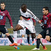 Genclerbirligi's Radosav Petrovic (L) Mervan Celik (R) and Besiktas's Demba Ba (C) during their Turkish Super League soccer match Genclerbirligi between Besiktas at the 19 Mayis stadium in Ankara Turkey on Monday, 26 January 2015. Photo by Kurtulus YILMAZ/TURKPIX