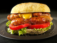 Traditional chipolatta pork sausages with mustard sandwich