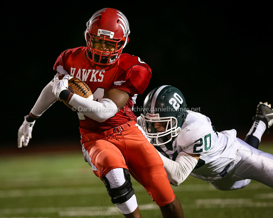 (10/2/14, MILFORD, MA) Milford's Quentin Orr carries the ball for a first down during the football game against Canton Milford High School on Thursday. Daily News and Wicked Local Photo/Dan Holmes